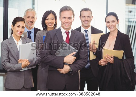 Portrait of business team with document and organizer in office - stock photo