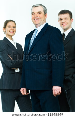 Portrait of business team with mature leader in front - stock photo
