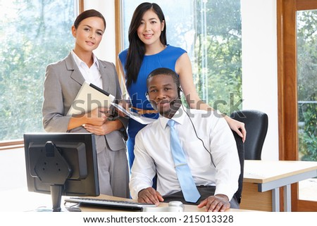 Portrait Of Business Team Working In Office - stock photo