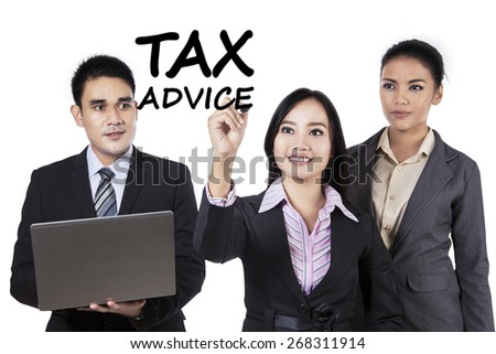 Portrait of business team writes tax advice on whiteboard, isolated on white background - stock photo