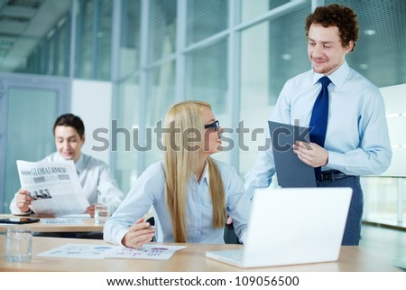 Portrait of business woman discussing ideas with her colleague - stock photo
