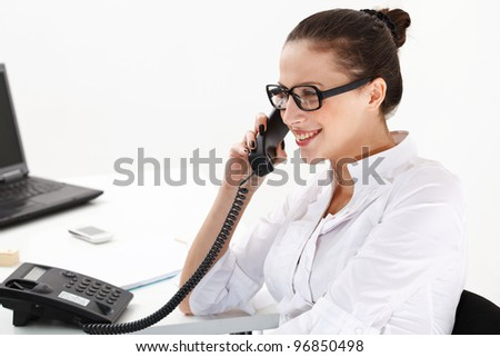 Portrait of  business woman discussing on phone over white background - stock photo