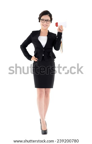 Portrait of business woman holding a megaphone in one hand