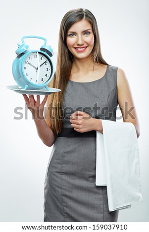 Portrait of business woman holding watch. Business time concept.