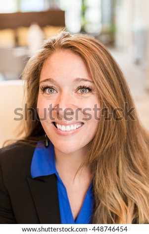 Portrait of business woman in blue shirt.