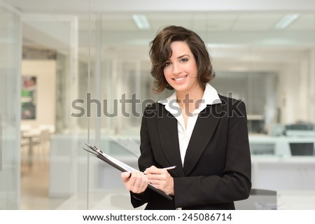 Portrait of business woman in modern office interior  - stock photo