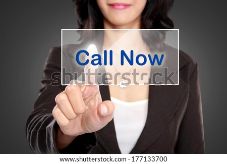 portrait of Business woman push to Call Now button on virtual screen - stock photo