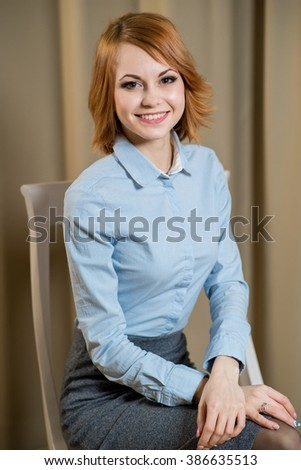 Portrait of business woman sitting on the chair