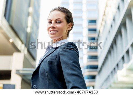 Portrait of business woman smiling outdoor