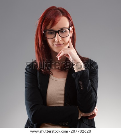 Portrait of business woman thinking about something - stock photo