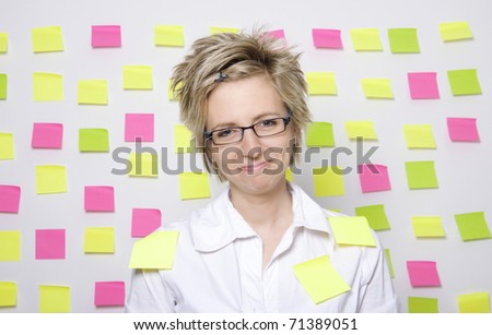 Portrait of business woman with note papers - stock photo