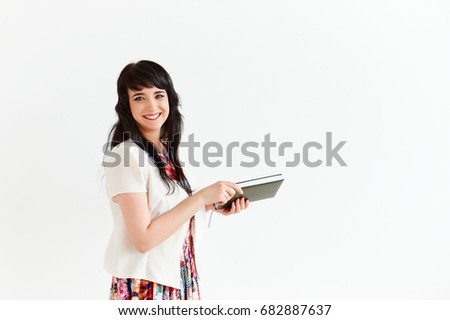 Portrait of business woman with Notepad on white background