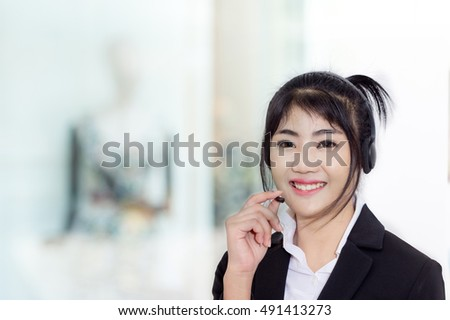 portrait of business women call center or female customer support phone operator 20-30 years old wearing microphone headset at Customer Service has confidence in providing good service and friendly.