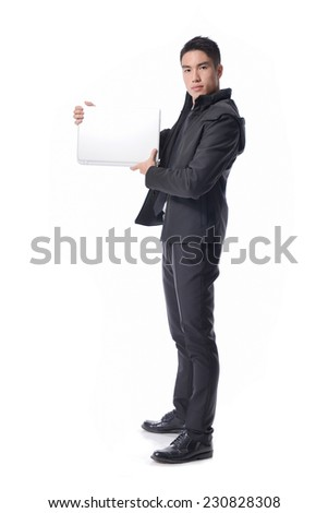 Portrait of business young man holding laptop of Asian, full length portrait  - stock photo