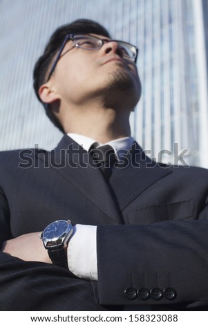 Portrait of businessman by the world trade center in Beijing - stock photo