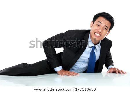 Portrait of businessman climb the wall isolated on the white background - stock photo