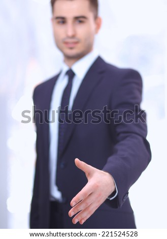 Portrait of businessman giving hand for handshake, isolated on