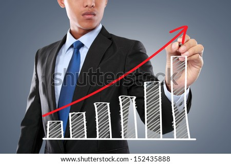 portrait of businessman hand drawing virtual chart on touch screen computer - stock photo