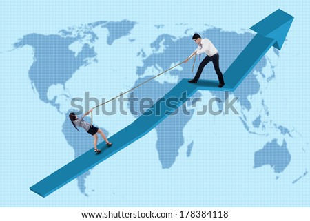 Portrait of businessman help his partner to climb the graph by pulling her with a rope - stock photo