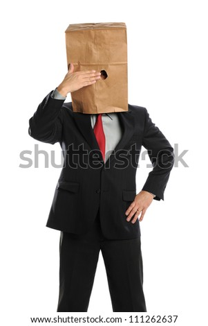 Portrait of businessman hiding behind paper bag isolated over white background