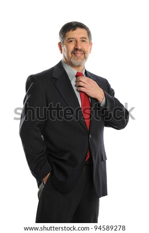 Portrait of businessman holding his tie isolated on a white background