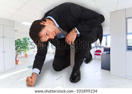 Portrait of businessman in a small office - stock photo