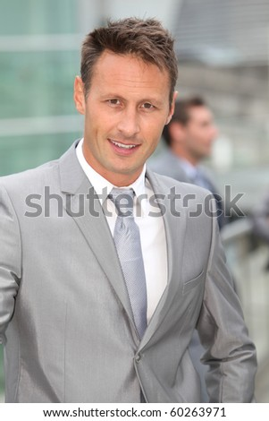 Portrait of businessman in grey suit - stock photo