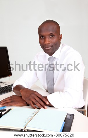 Portrait of businessman in office - stock photo