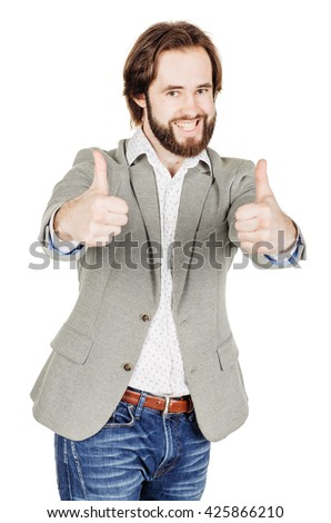 Portrait of businessman looking at camera and showing his thumb up while standing against white background - stock photo