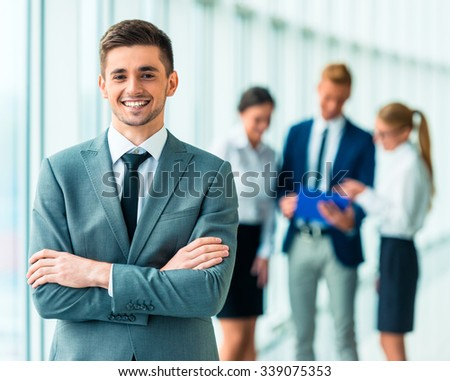 Portrait of businessman on the background of their colleagues in the office