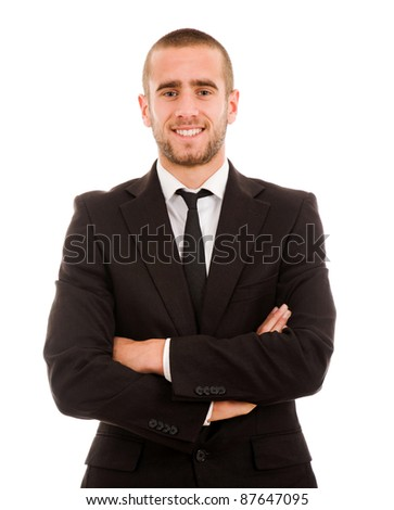 Portrait of businessman standing against isolated white background