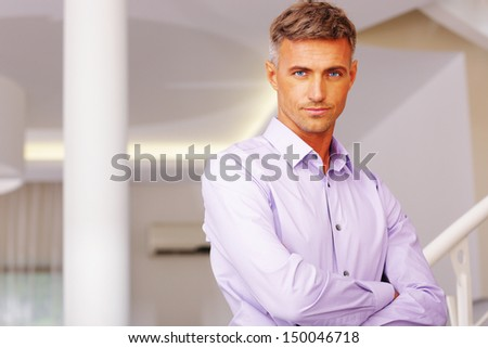 Portrait of businessman standing in hall