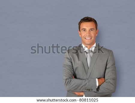 Portrait of businessman standing with arms crossed - stock photo