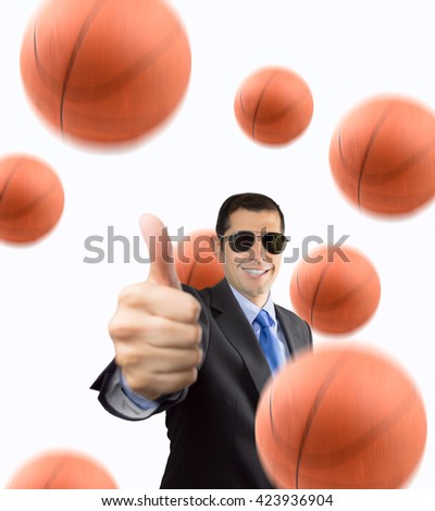 Portrait of businessman standing with thumbs up because he does likes basketball isolated on white background - stock photo