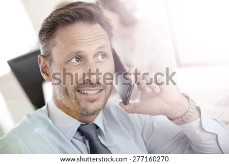 Portrait of businessman talking on mobile phone - stock photo