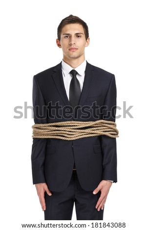 Portrait of businessman tied with the line, isolated on white. Concept of slavery and violence - stock photo