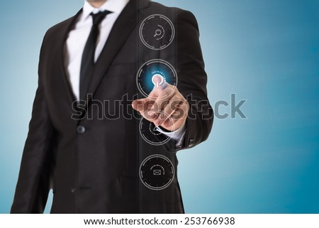 Portrait of businessman touching buttons on invisible screen. Gradient background. - stock photo