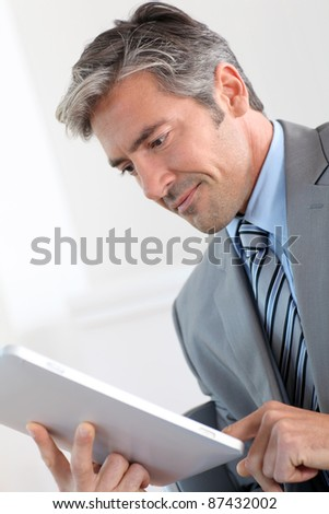 Portrait of businessman using electronic tablet