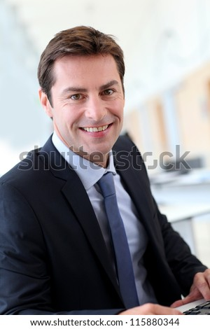 Portrait of businessman wearing dark suit - stock photo