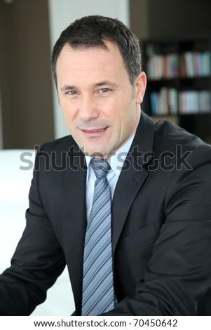 Portrait of businessman wearing dark suit - stock photo