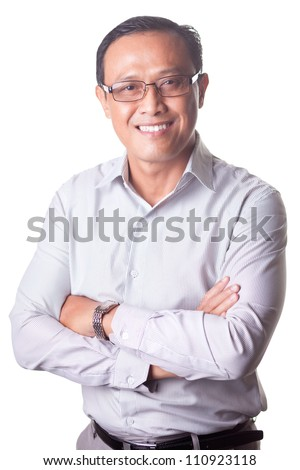 Portrait of businessman wearing glasses looking at camera on white background - stock photo