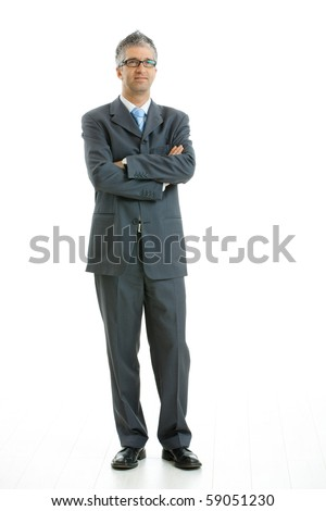 Portrait of businessman wearing gray suit and glasses, standing with arms crossed, smiling.  Isolated on white background. - stock photo