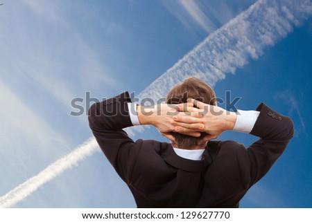 Portrait of businessman who dreams - stock photo