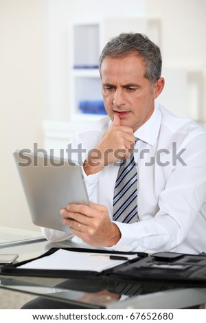 Portrait of businessman with electronic tab