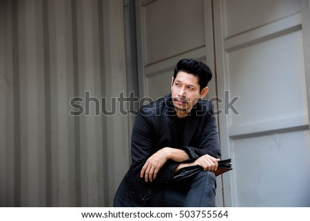 Portrait Of Businessman ,Young Handsome Man Sitting Outdoors,Lifestyle
