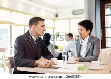 Portrait of businessmen and businesswomen at meeting - stock photo