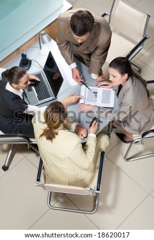 Portrait of businesspeople interacting and brainstorming together at meeting - stock photo