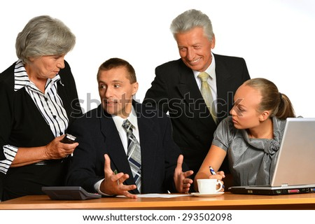 Portrait of businesspeople working with laptop on white background - stock photo