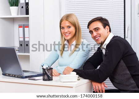 Portrait of businesswoman and businessman sitting in office,Teamwork - stock photo