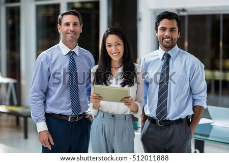 Portrait of businesswoman and businessmen with digital tablet in the office